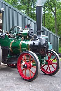 Green steam engine being moved outside to be sold at Kivells heritage sale