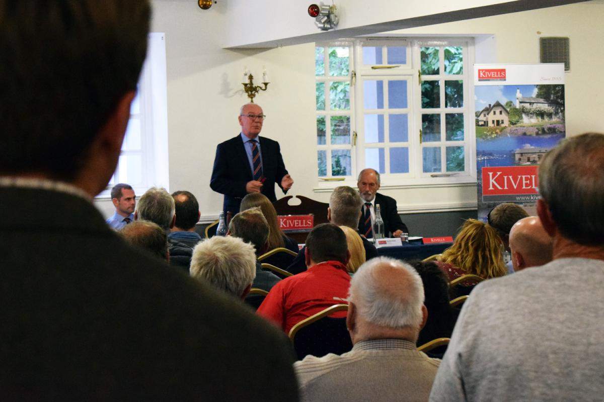 Kivells Director Simon Alford conducts the property auction in front of a room of bidders