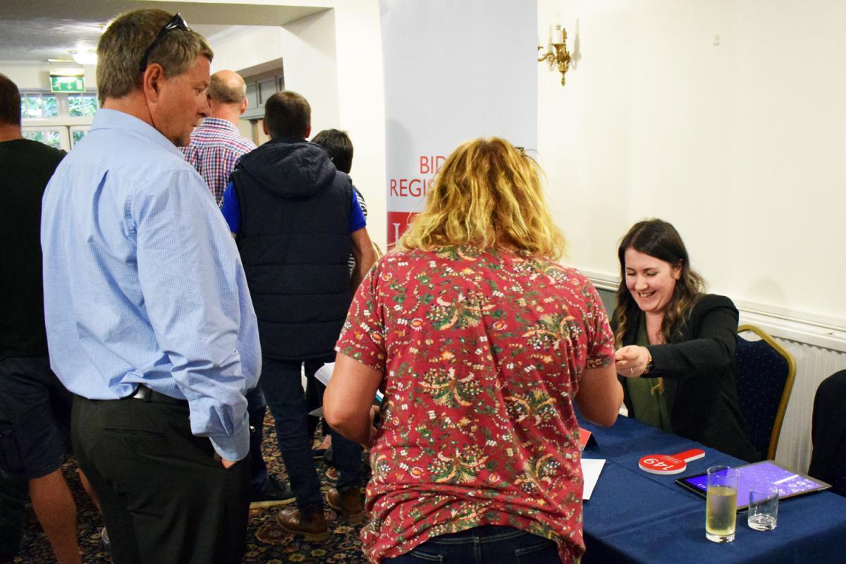 Kivells Callington Sales Negotiator Amanda Holt registering property auction bidders