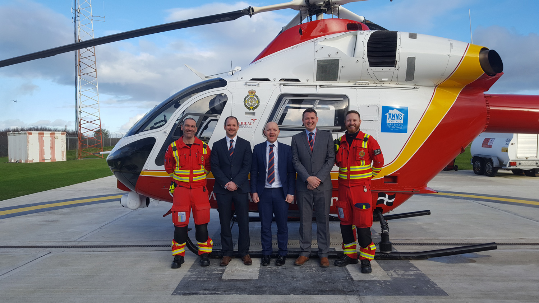 Kivells staff and Cornwall Air Ambulance crew with the Cornwall Air Ambulance helicopter