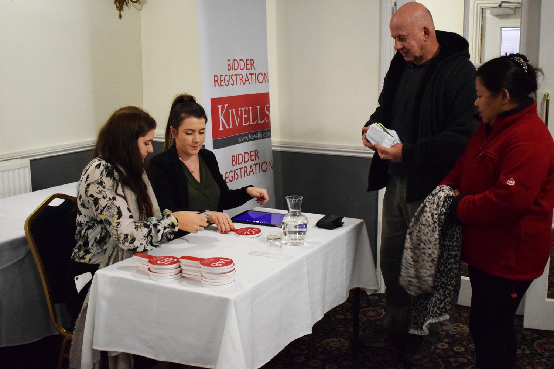 Kivells Beth Cribb and Amanda Holt registering bidders