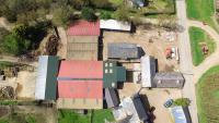 Aerial view of barns, buildings and land at Borough Bridgerule for sale
