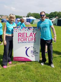 Cancer Research Relay For Life - Jane and Richard with banner ready to start the relay