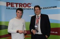 Kivells Residential Sales Negotiator James Petherick receiving his award from Bill Blythe, Vice Principal Finance & Resources, at the Petroc Awards