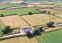 Aerial shot of Jenns Farm Bradworthy, farmhouse, agricultural buildings and land for sale with Kivells