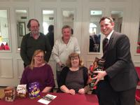 Kivells Area Manager Dan Stokes presenting quiz team winners with their prize inside the Falcon Hotel