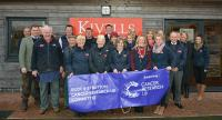 Kivells staff outside at Kivells Holsworthy Livestock Market with Cancer Research UK banner