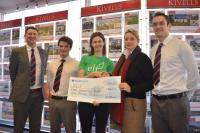 Staff from Kivells Holsworthy presenting a cheque to a fundraiser from ELF inside the Holsworthy branch