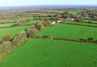 Higher Town Farm and Town Barton Aerial shot of farmhouse, outbuildings and green pasture land
