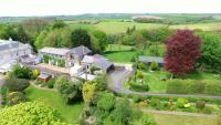 Aerial view of Longstone House, a five bedroom former coach house for sale with Kivells, with surrounding fields and countryside