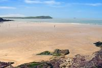 Sandy beach and blue sea and sky at Polzeath Beach