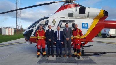 Kivells staff and Cornwall Air Ambulance crew with the Cornwall Air Ambulance helicopter