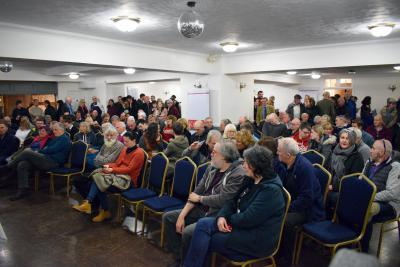 An auction room full of bidders