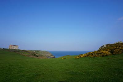 land and hotel at Tintagel with sea in the distance